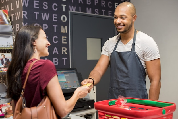Woman paying at supermarket