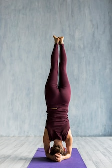 Woman performing a handstand