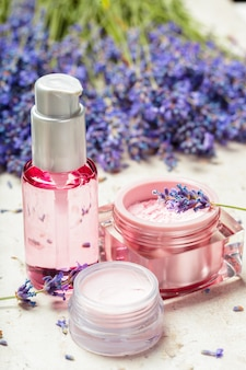 Woman perfume in beautiful bottle and lavender flowers
