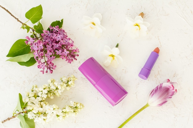 Woman perfume and flowers on the white background.