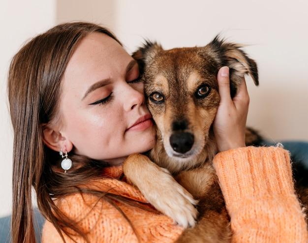 Woman petting adorable dog