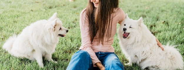 Woman petting adorable dogs