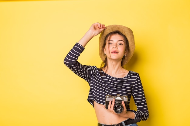 Woman photographer beauty caucasian brunette young girl on yellow background