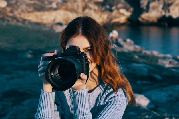 Woman photographer nature rocky mountains adventure vacation