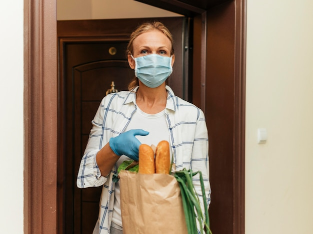 Woman picking up her groceries in self-isolation at home