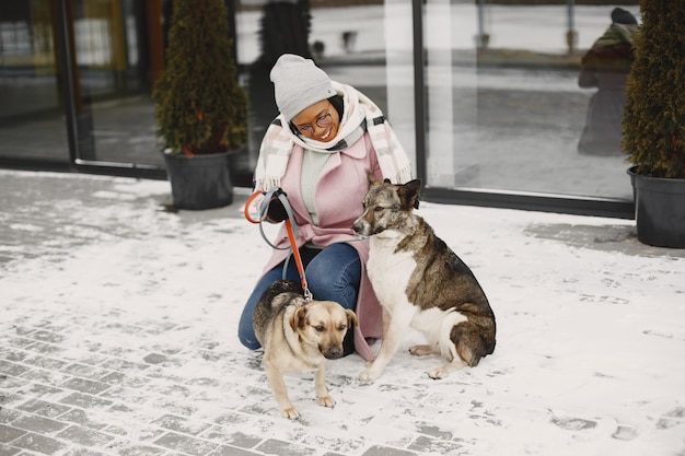 Woman in a pink coat with dogs