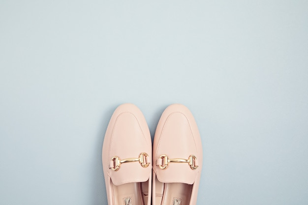 Woman pink pastel shoes over blue wall. fashion blog, sprind and summer urban style, online shpping. minimal flat lay, top view, copy space