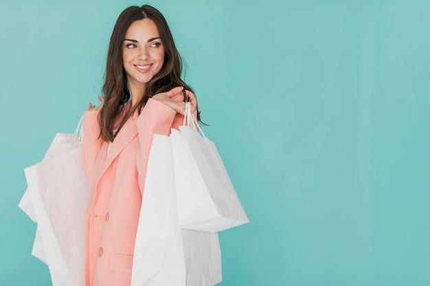 Woman in pink suit looking sideway