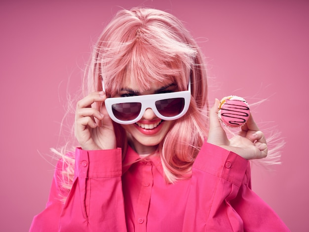 Woman in a pink wig, clothes with food