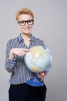 Woman planning travel around the world