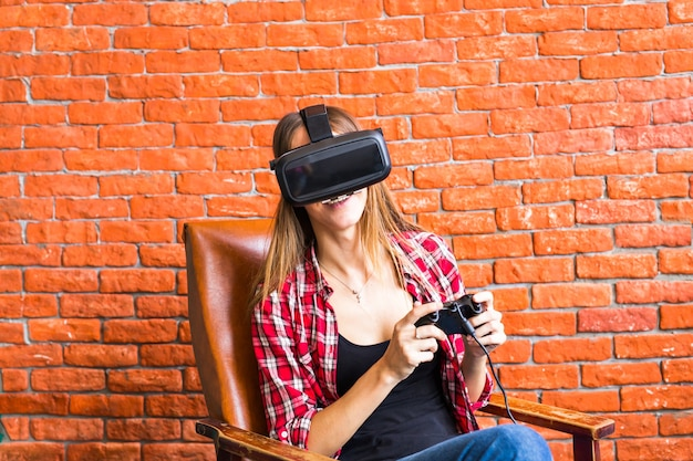 Woman play video game with joystick and vr device.