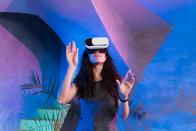 Woman playing games on vr set indoors