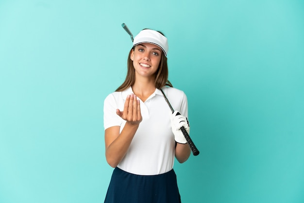 Woman playing golf isolated blue background inviting to come with hand