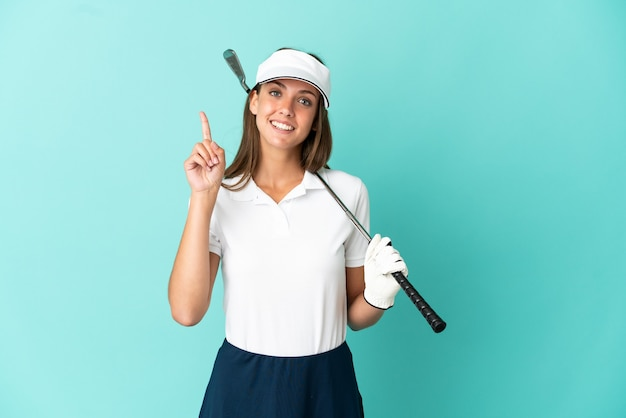 Woman playing golf over isolated blue background pointing up a great idea