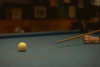 Woman playing pool at a bar
