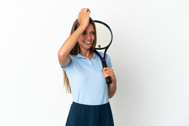 Woman playing tennis over isolated white wall has realized something and intending the solution
