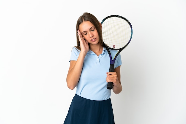 Woman playing tennis over isolated white wall with headache