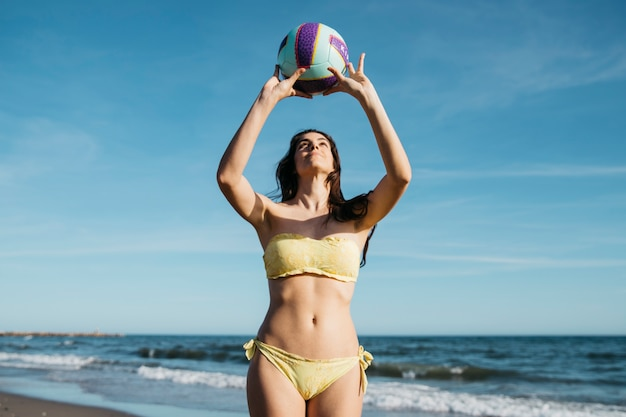 Woman playing volleyball at the beach