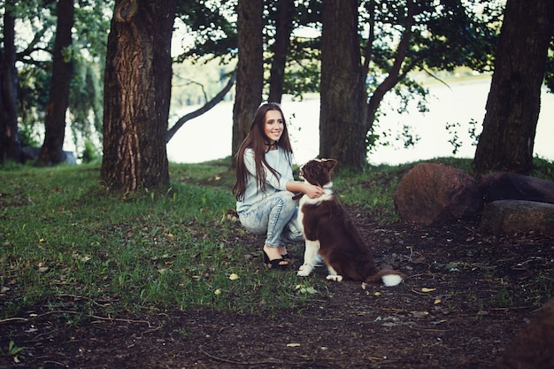 Woman playing with collie dog