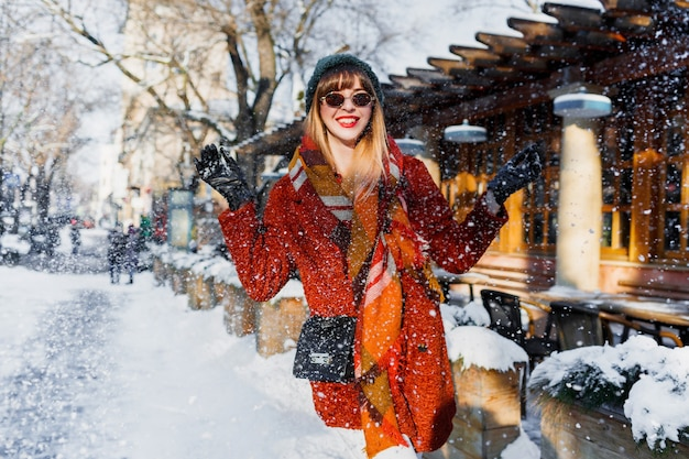 Woman playing with snow, having fun and enjoying holidays