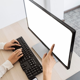 Woman pointing to a blank desktop screen