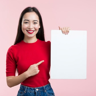 Woman pointing at blank paper sheet