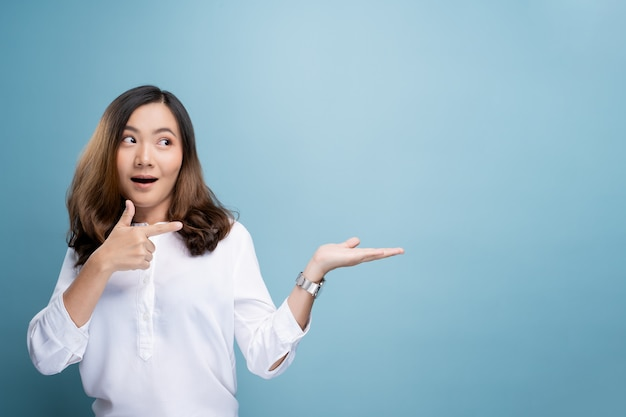 Woman pointing to copy space