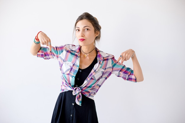 Woman pointing fingers down ready to solve problems