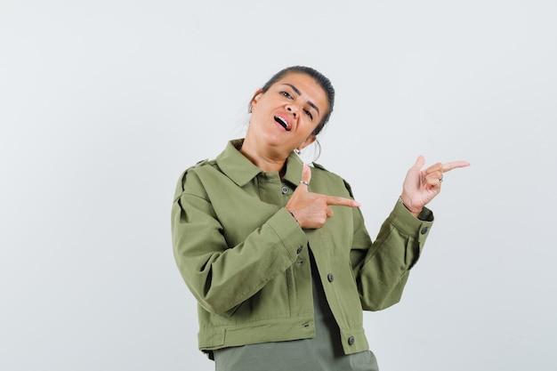 자 켓, t- 셔츠에서 오른쪽을 가리키고 자신감을 찾고 여자.