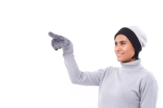 Woman pointing up, fall or winter outfit