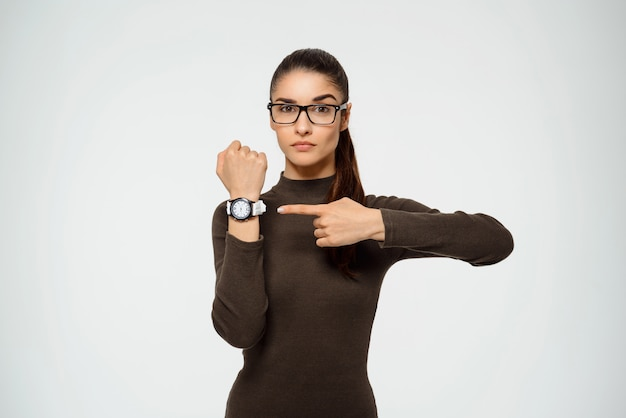 Woman pointing watch, time is running out