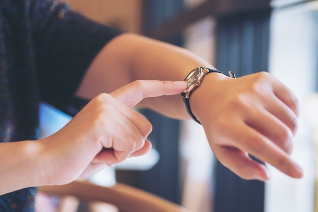 Woman pointing at a watch