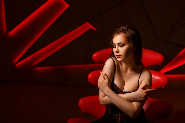 Woman portrait on a red background, emotions