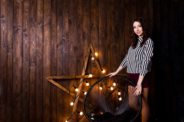 Woman posing against light star