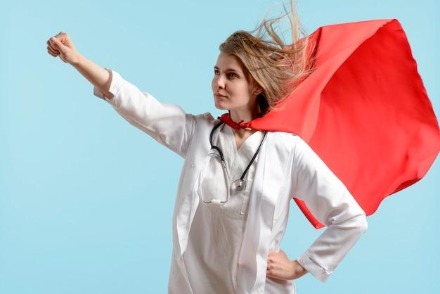 Woman posing as super hero