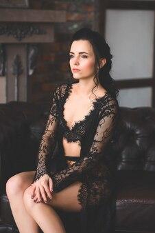 Woman posing in black lace lingerie