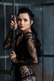 Woman posing in black lace lingerie.