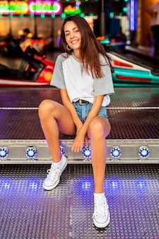 Woman posing at bumper cars