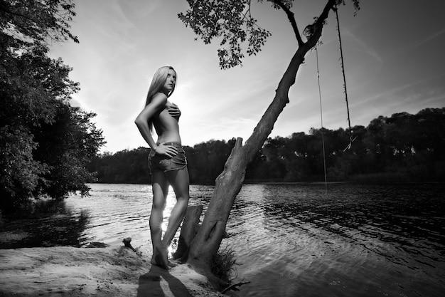 Woman posing near a lake