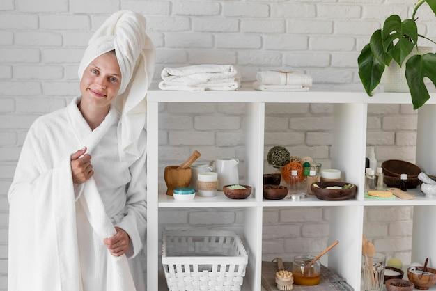Woman posing near natural ingredients