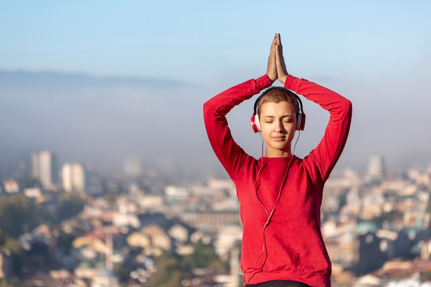 Woman posing outdoors medium shot