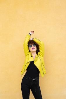 Woman posing on plain background