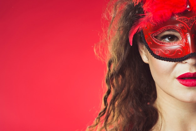 Woman posing in red mask