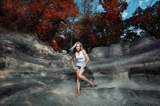 Woman posing on the rocks in a forest