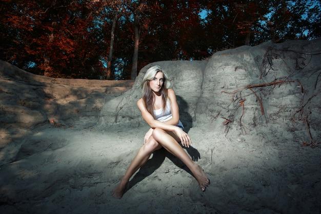 Woman posing on the rocks