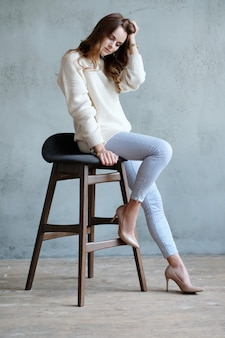 Woman posing sitting on a chair