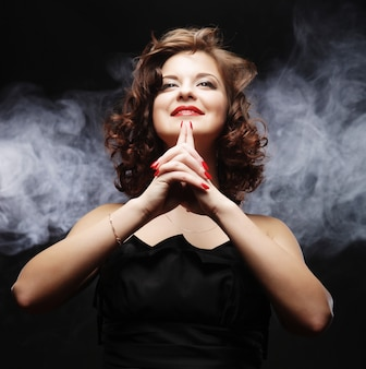 Woman posing over smoke background