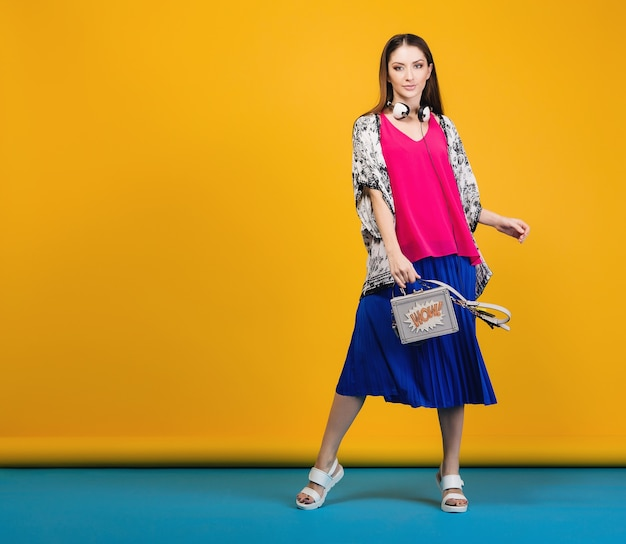 Woman posing in stylish summer fashion and bag colorful mood