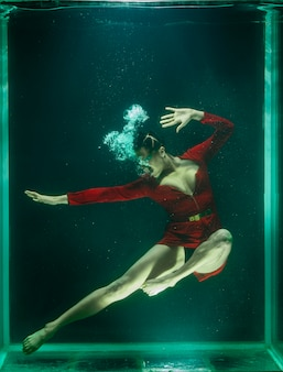 Woman posing under the water