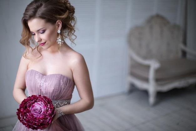 Woman posing in a wedding dress.